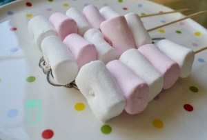 Thread Marshmallows onto shish kebob